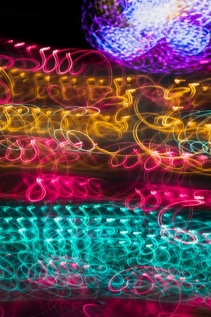Colorful illuminated background neon lights Free Photo
