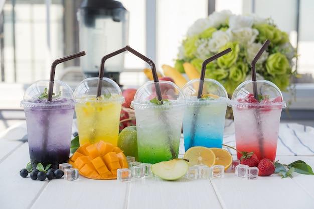 Colorful italian soda arranged on wood table Premium Photo