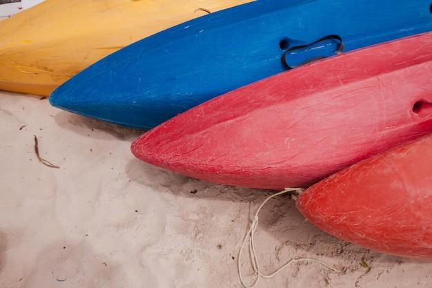 Colorful kayaks on beach Free Photo
