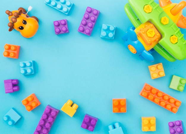 Colorful kids toys frame on blue background. top view for ...