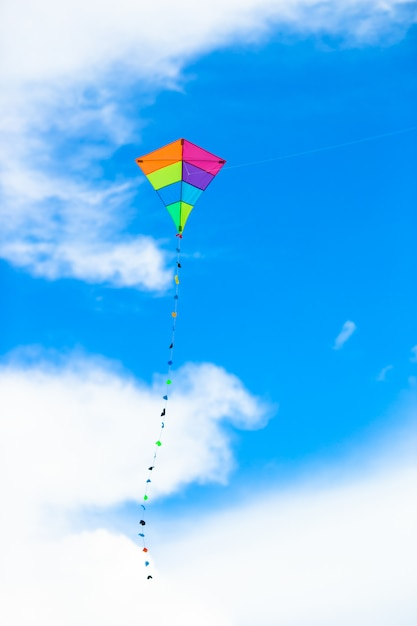 Colorful kite flying in the wind background blue sky Premium Photo