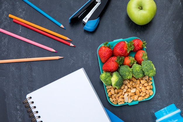 Colorful lunch with stationery on table Free Photo