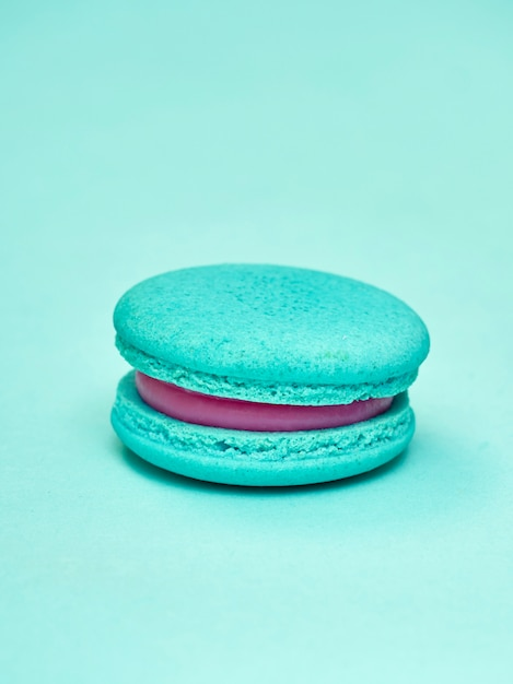 Colorful macarons on a blue background Premium Photo