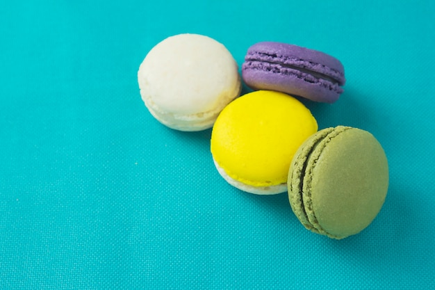 Colorful macaroon  on blue background Free Photo