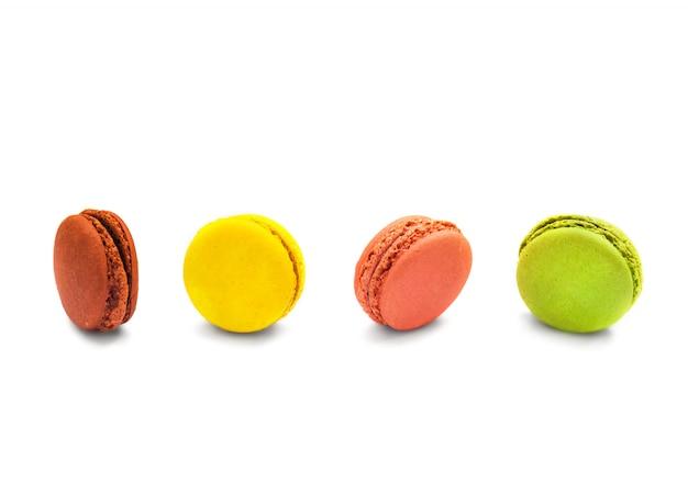 Colorful macaroons isolate on white. Premium Photo
