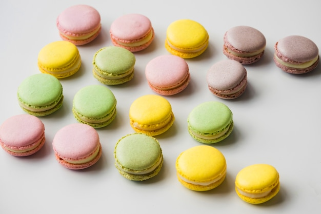 Colorful macaroons on white backdrop Free Photo