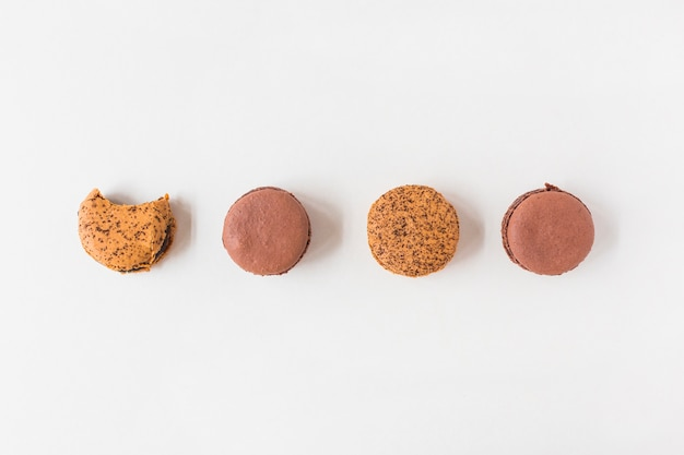 Colorful macaroons on white background Free Photo