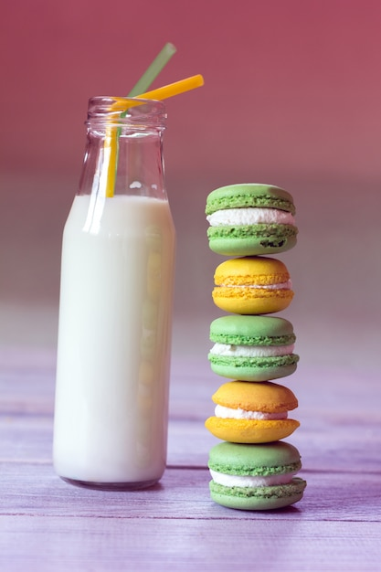 Colorful macaroons with milk Premium Photo