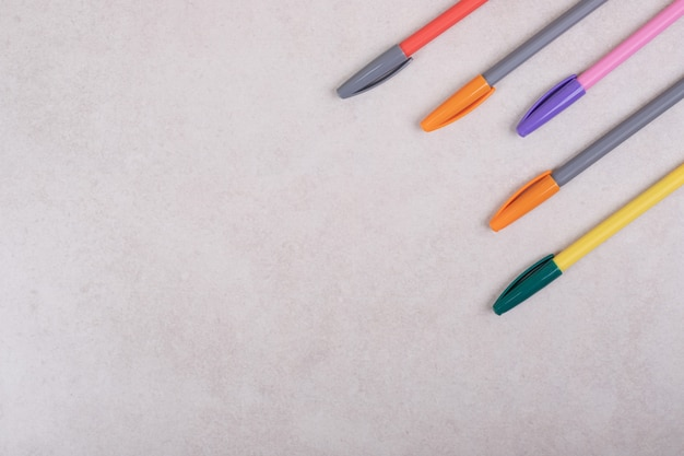 Colorful marker pens on white background Free Photo