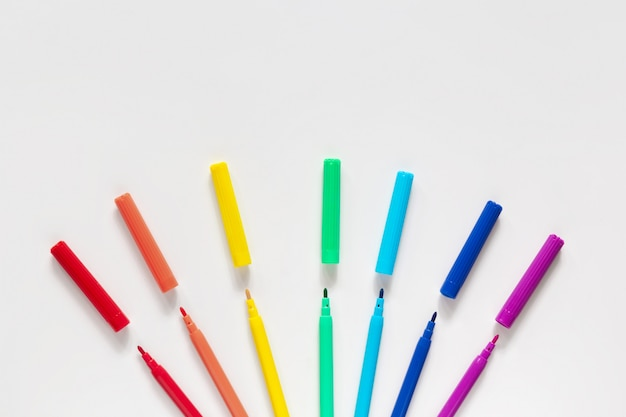 Colorful markers on white surface Premium Photo