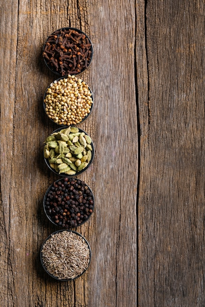 Colorful mix of different spices  on a wooden board Premium Photo