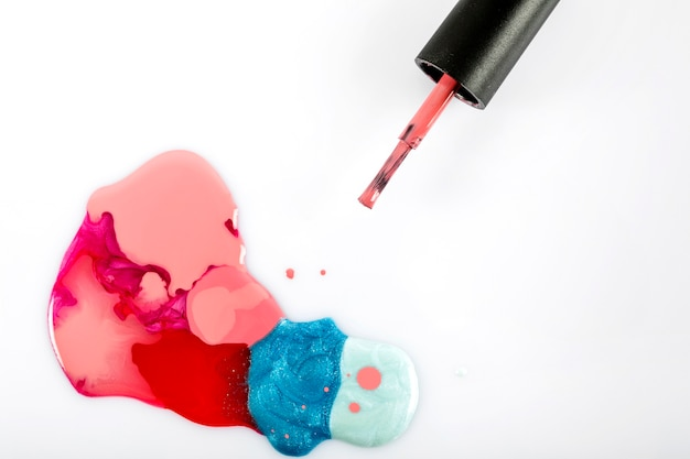 Colorful nail polish on white backdrop Free Photo