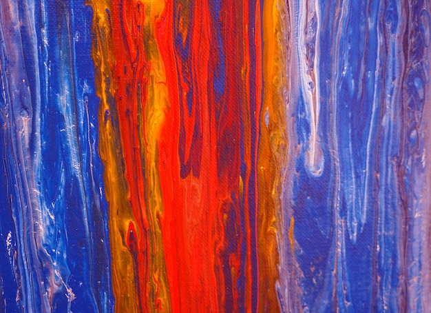 Colorful oil paint flowing on canvas. Premium Photo