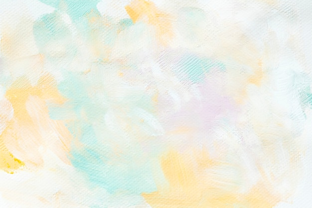 Colorful paint on a canvas Free Photo