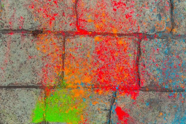Colorful paint on paving stone Free Photo
