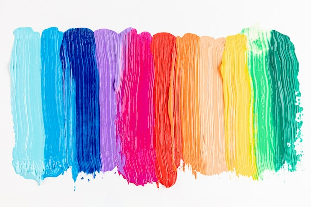 Colorful paint strokes on white background Free Photo