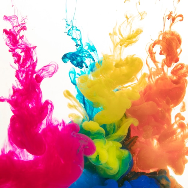 Colorful paints diffusing in water