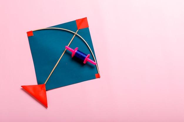 Colorful paper kites and string , makar sankranti festival concept Premium Photo