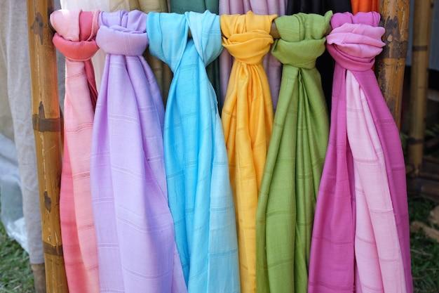 Colorful pashmina scarves at an outdoor market Premium Photo