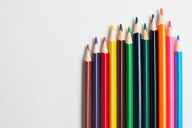 Colorful pencils on the white background, for kids drawing Premium Photo