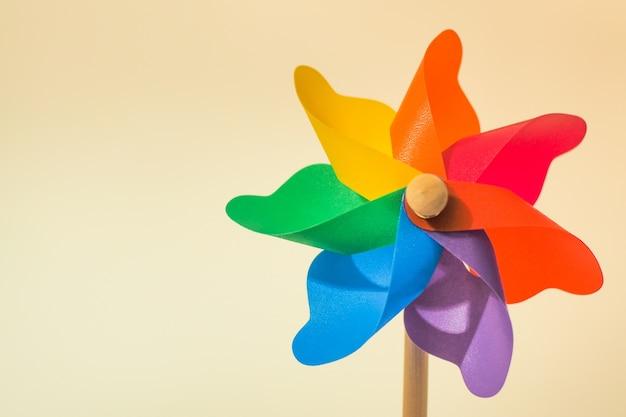 Colorful pinwheel toy on white background Premium Photo