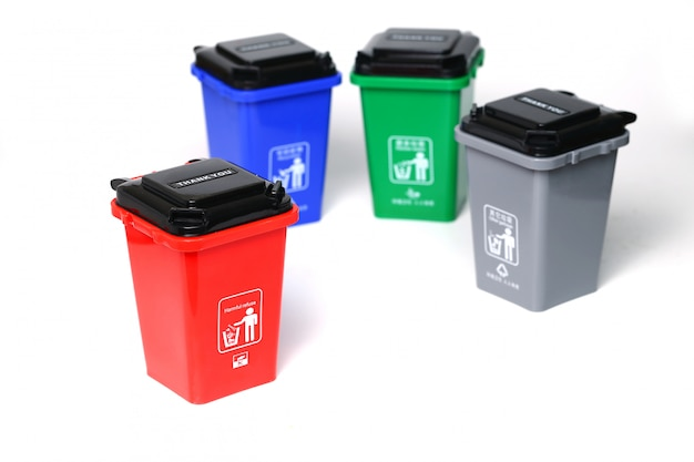 Colorful plastic garbage cans isolated on white Premium Photo