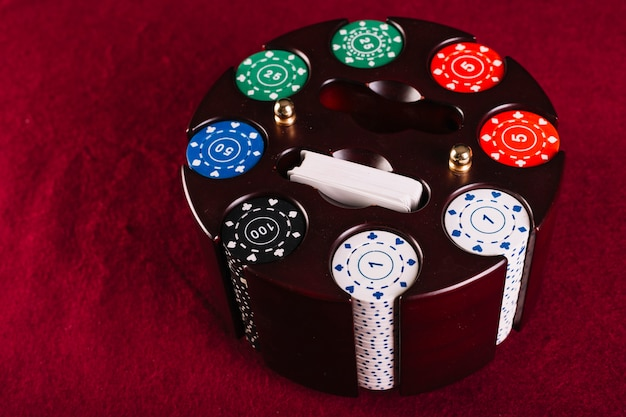 Colorful poker chip set in carousel case Free Photo