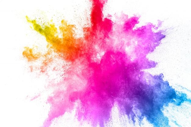 Colorful powder explosion. abstract pastel color dust particles splash. Premium Photo