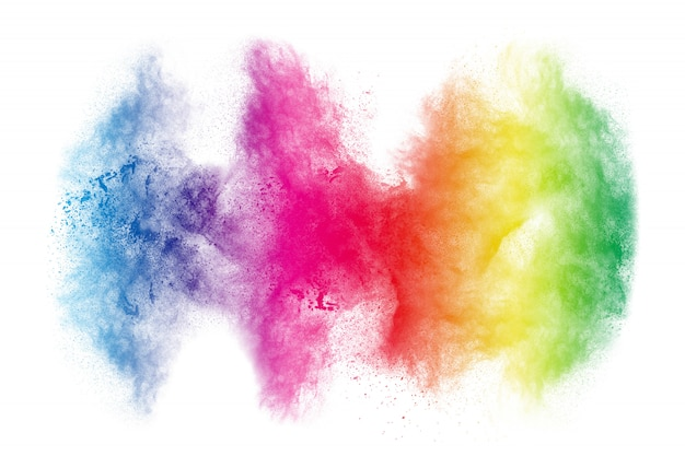 Colorful powder explosion on white background. abstract pastel color dust particles splash. Premium Photo