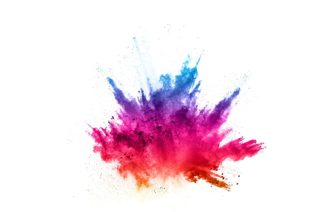 Colorful powder explosion on white background. colored cloud. colorful dust explode. Premium Photo