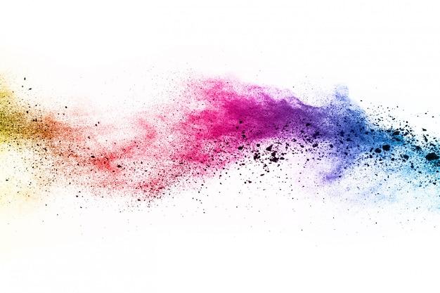 Colorful powder explosion on white background. Premium Photo