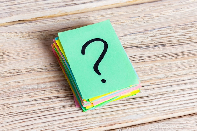 Colorful question marks written reminders tickets. ask or business concept Premium Photo