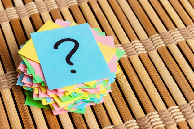 Colorful question marks written reminders tickets. Premium Photo