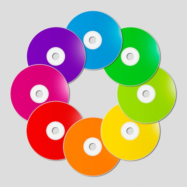 Colorful rainbow cd - dvd in a circle shape on grey background Premium Photo