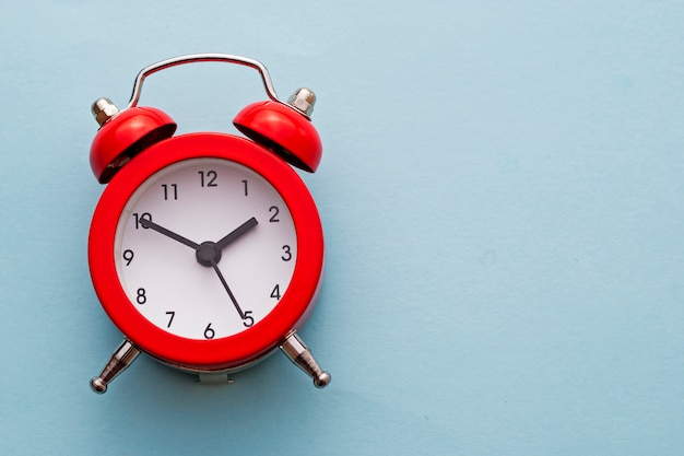 Colorful red traditional alarm clock with bells Premium Photo