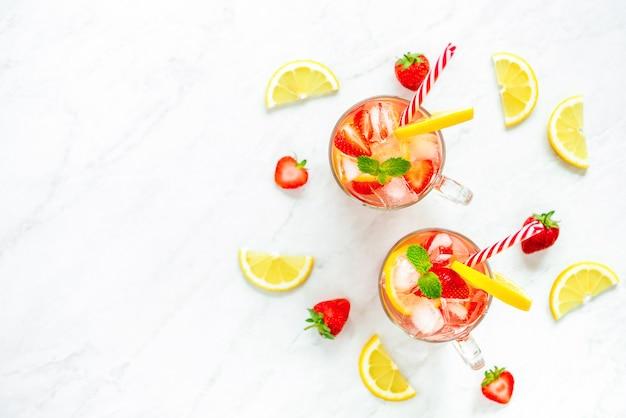 Colorful refreshing strawberry lemonade juice drinks for summer, Premium Photo