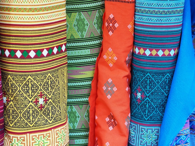 Colorful rolls of fabric pattern backgrounds. Premium Photo