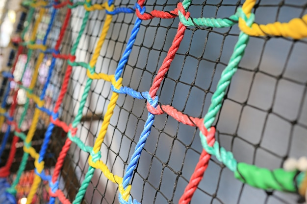 Colorful rope net tied for climb. indoors playground. Premium Photo