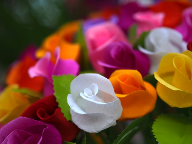Colorful roses paper background. Premium Photo