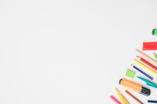 Colorful school accessories on corner of the white background Free Photo