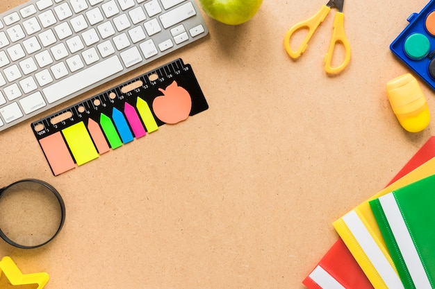 Colorful school and office equipment on beige background Free Photo