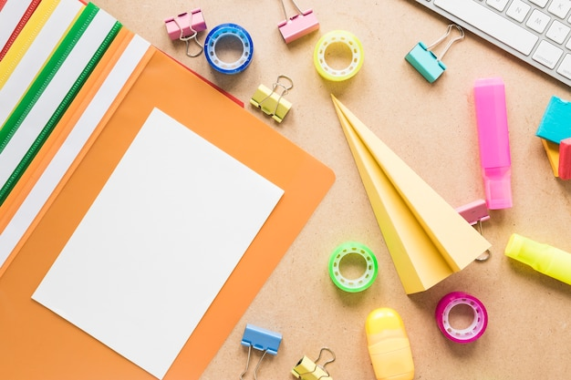 Colorful school and office equipment on plain background Free Photo