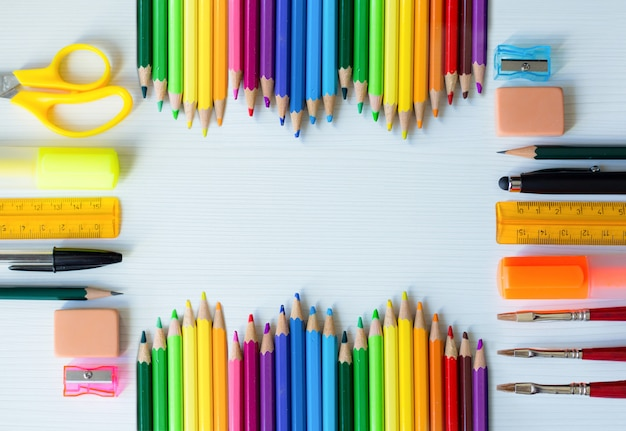 Colorful school and office supplies background with space to text design Premium Photo