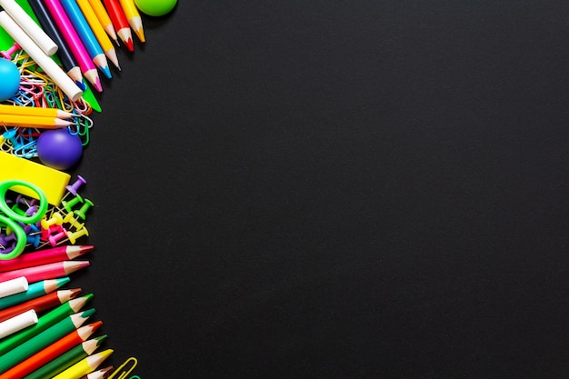 Colorful school supplies background. top view. copy space. Premium Photo