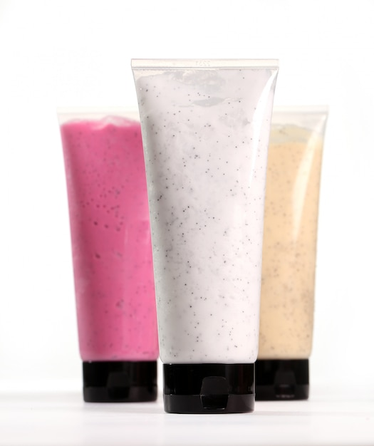 Colorful scrubs in tubes Free Photo