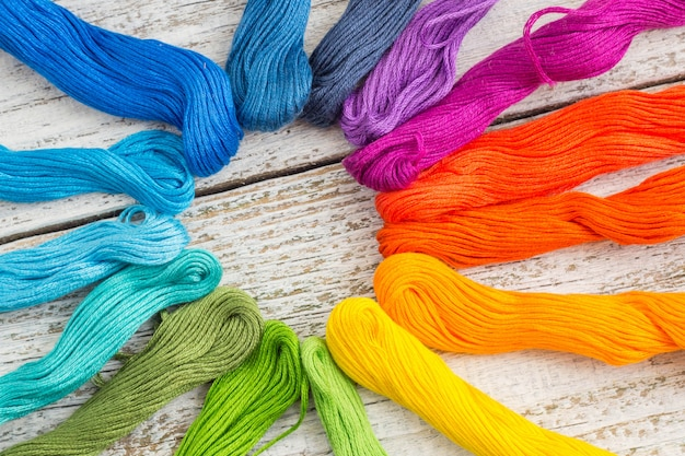 Colorful sewing threads for embroidery on white background Premium Photo