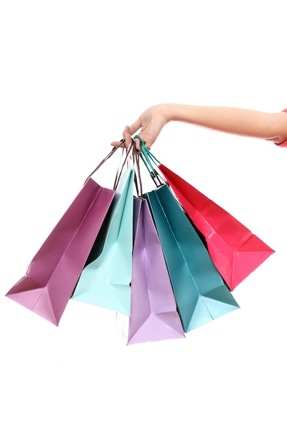 Colorful shopping bags in hand Free Photo