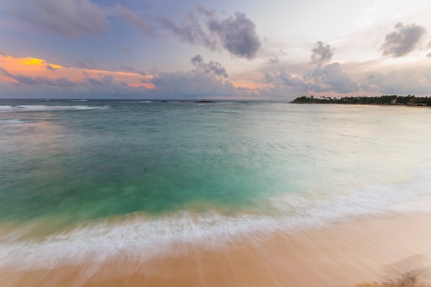 Colorful sky at sunset on desert tropical beach Premium Photo