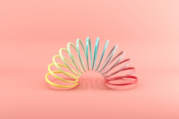 Colorful slinky isolated on pink Premium Photo