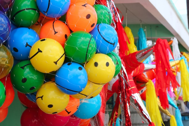 Colorful smiley balls and party pinata Premium Photo